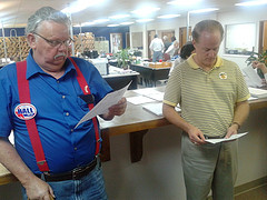 Hall and Page examining precinct results