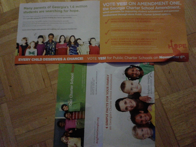 Two glossy mailers pushing the charter school amendment