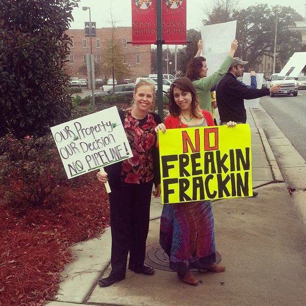 Our Property, Our Decision, No Pipeline (Ashlie Marie Prain), No Freakin Frackin (Mary Booker), in My fellow protesters and me at the spectra energy commissioner's meeting, by Mary Booker, for Lowndes Area Knowledge Exchange, 9 December 2013