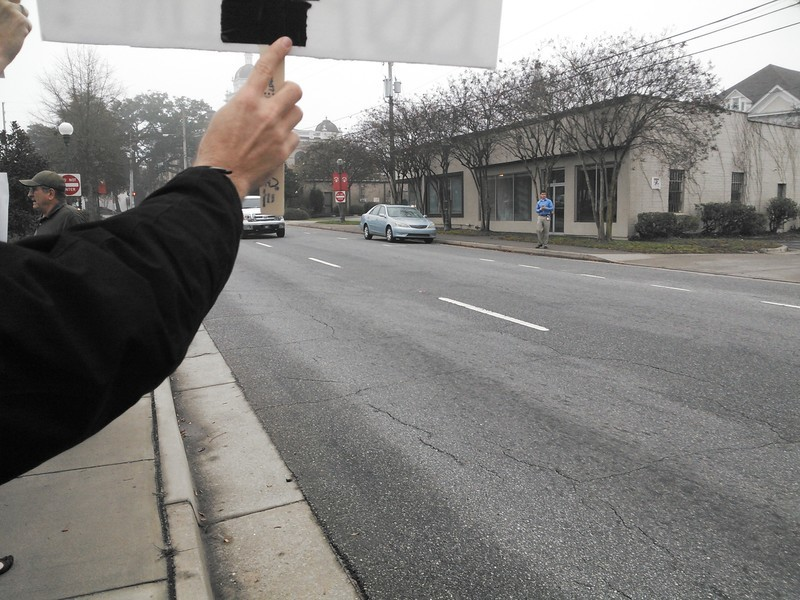 VDT Reporter Matthew Woody across the street, in People v. Spectra @ LCC 2013-12-09, by John S. Quarterman, for Lowndes Area Knowledge Exchange (LAKE), 9 December 2013
