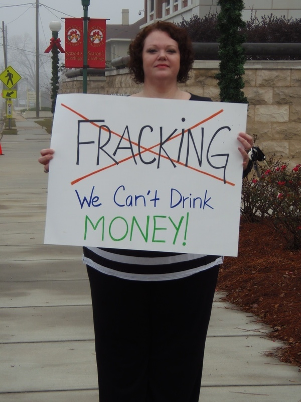 Andi Ray Drake (No Fracking; We Cant Drink Money!), in No pipeline no fracking: protest before Spectra at Lowndes County Commission, by Gretchen Quarterman, for Lowndes Area Knowledge Exchange (LAKE), 9 December 2013