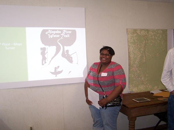 600x450 Maya Turner with her First Place logo, in Logo Winners, by Deanna Mericle, 14 March 2015